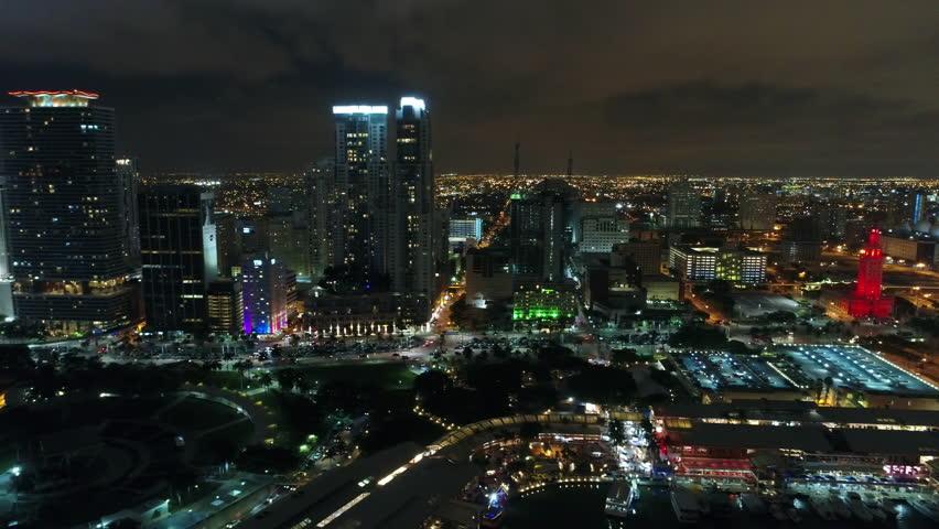 MIAMI, FL, USA - JUNE 11, 2017: Illuminated city at night aerial tour video 4k 24p prores