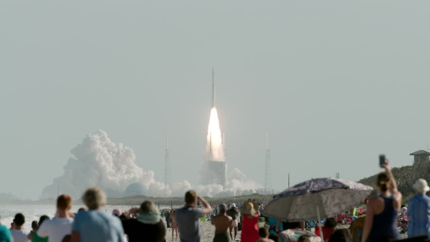 Rocket launch in Florida with people in the foreground watching lift-off - super slow motion
