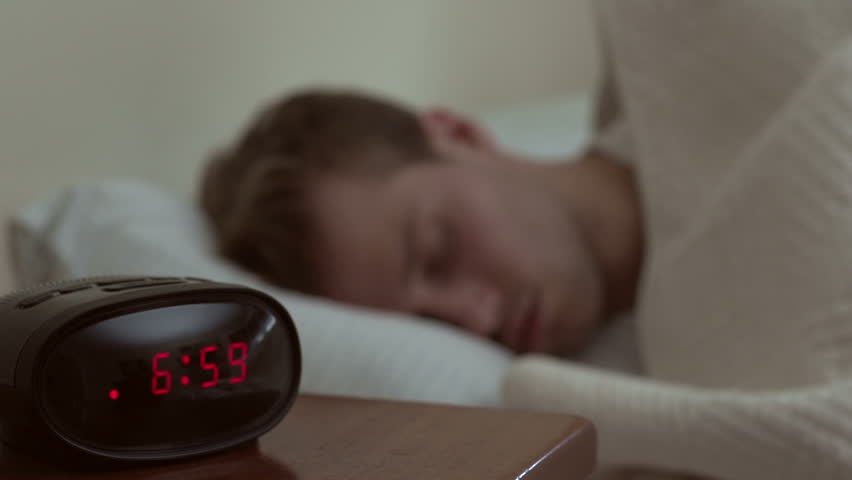 Man waking up to his alarm | Shutterstock HD Video #2782786