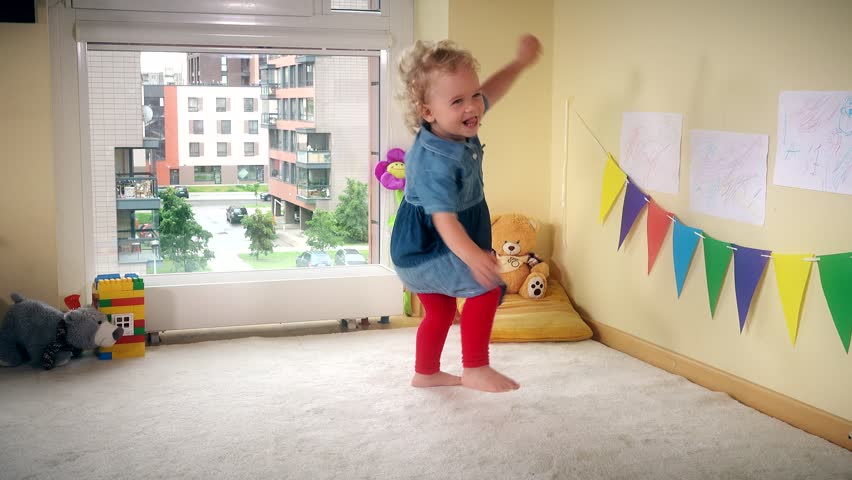 Wicked kid at home. Active girl run jump and dance with energy. 4K | Shutterstock HD Video #27851155