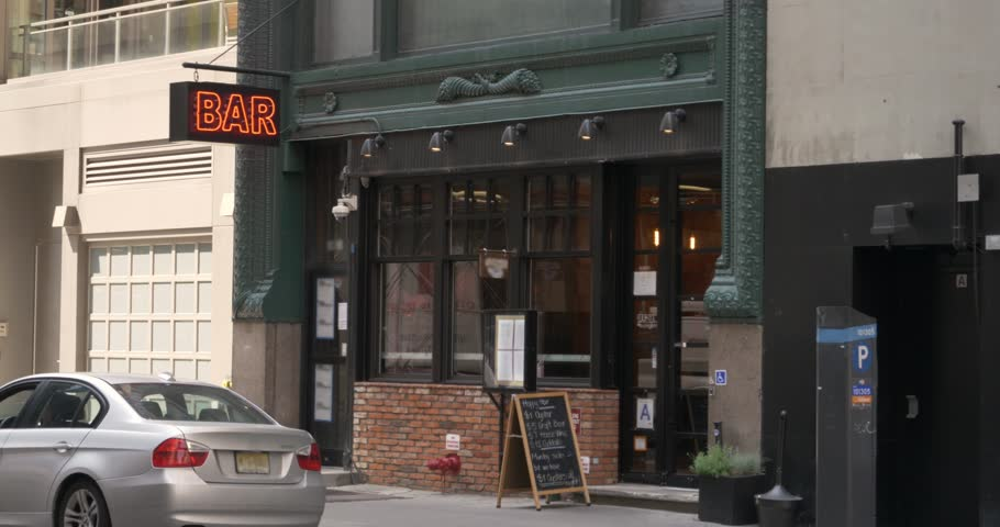 A daytime exterior establishing shot of a bar and restaurant in downtown Manhattan, New York City.  Day/Night matching available. | Shutterstock HD Video #27851215