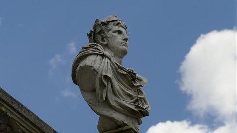 JUN 08, 2017, MOSCOW, RUSSIA: Clouds running over Gaius Julius Caesar statue in Museum-Estate Arkhangelskoye