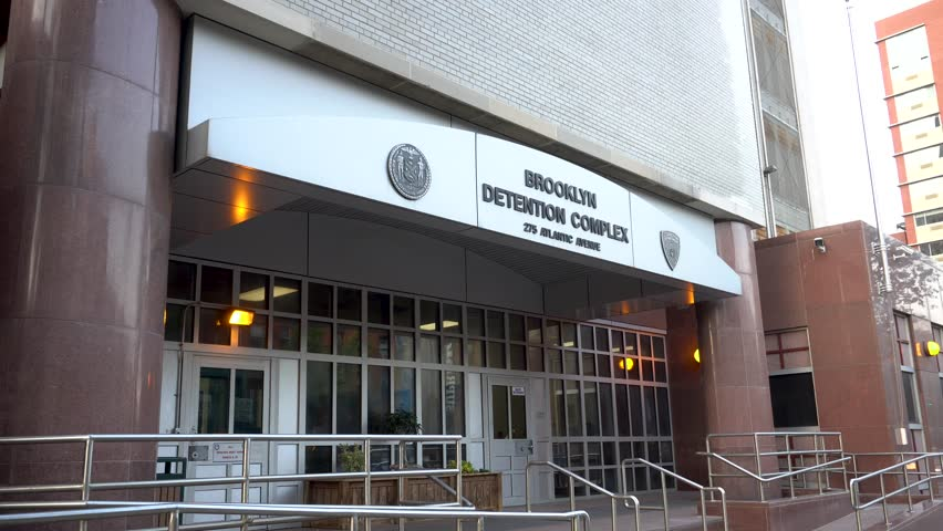 New York City, Circa 2017: Brooklyn Detention Center NYPD facility exterior day establishing shot DX. Police department arrest and Lock up criminals in rikers jail