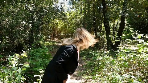 Scared terrified Woman Running Away From somebody Into Forest- slow motion
