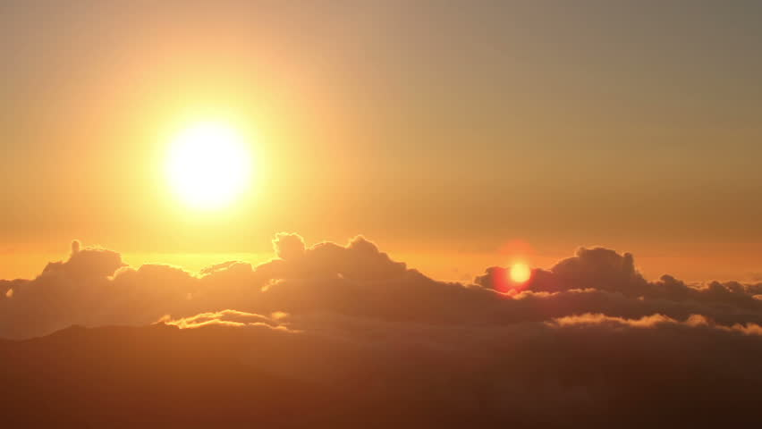 Red sun disk time lapse dawn with flowing cloud waves HDR, shot at Haleakala National Park, Hawaii #2786665