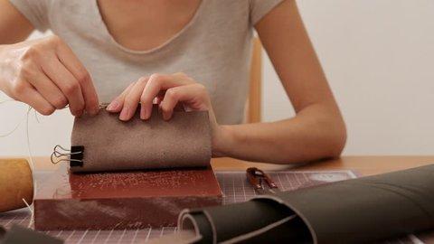 Female craftswoman design a leather bag