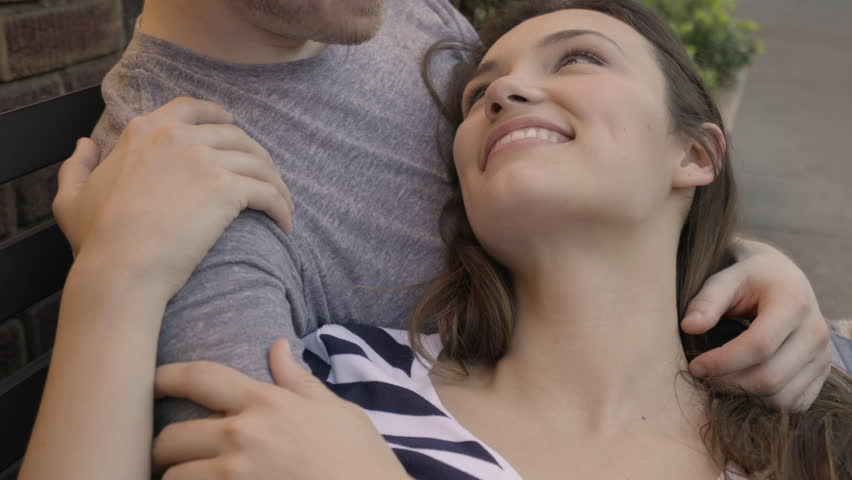 Closeup Of Couple Cuddling On A Bench Outside Of Restaurant | Shutterstock HD Video #27951895