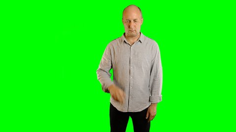 Gestures on greenscreen adult caucasian man. Alpha channel matte png studio shot. Model adult men. Hand gestures virtual screen modern techology. Template advertising HoReCa hotel restaurante cafe.