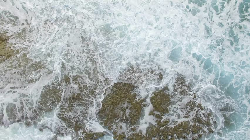 watch waves crash at bahamas stocking island with beach reveal tilt aerial #28040293