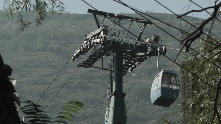 Cable cars ascending to the Lanshan Mountain from the Five-Spring Mountain cable car station. Lanzhou, China.