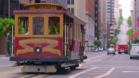 SAN FRANCISCO, CA - CIRCA APRIL 2017: San Francisco cable car drives downtown city street. 4K.