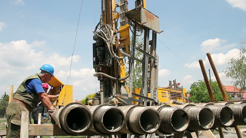 Workers operate a drilling rig for a Natural-gas. HD1080p.