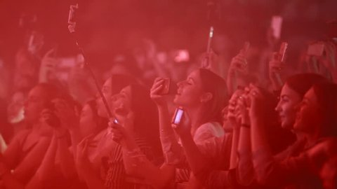 VINNITSA, UKRAINE - JUNE 2017: Music fans takes smartphone video records at party