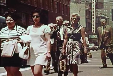 1970s: A segment from a 1970s film about unemployment insurance features construction and corporate workers, plus pedestrians and people doing grocery shopping.