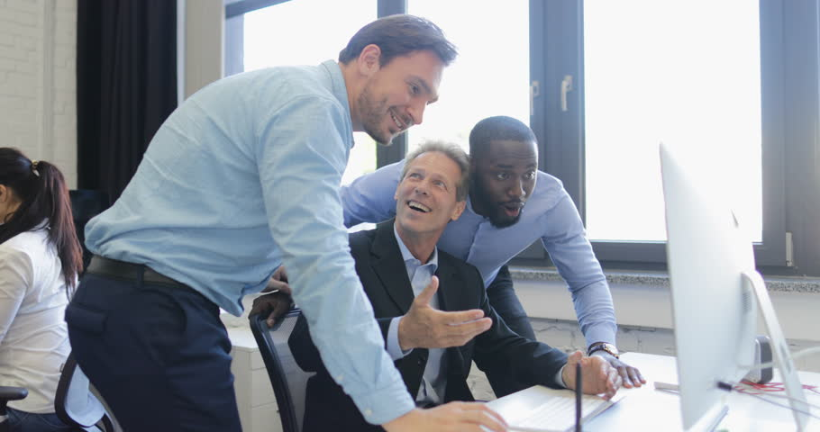 Happy Smiling Businessmen Group Discussing Point On Computer Screen, Business People Team Talking About Good Results   | Shutterstock HD Video #28088605