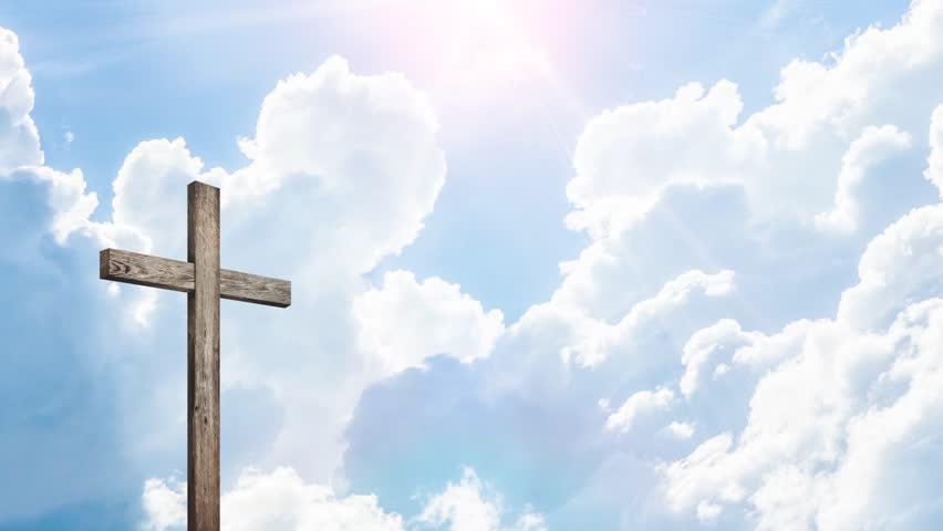 calvary gold cross of christ light background stock