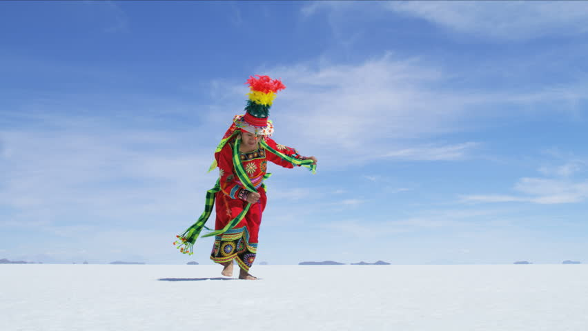 View of Bolivian Latin American female proudly performing traditional dance in National dress on South American Salt flats RED WEAPON | Shutterstock HD Video #28100125
