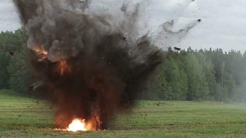 Explosion throws earth fire and smoke. Simulation of the explosion of a small caliber projectile.