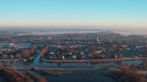 Aerial view of the village Terheijden in Noord-Brabant (The Netherlands) by drone. Filmed on a cold, frosty morning.