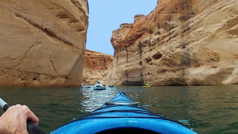 POV, point of view with go pro of kayakers paddling on Lake Powell in the Glen Canyon National Recreation Area.  Kayakers are in Antelope Canyon.