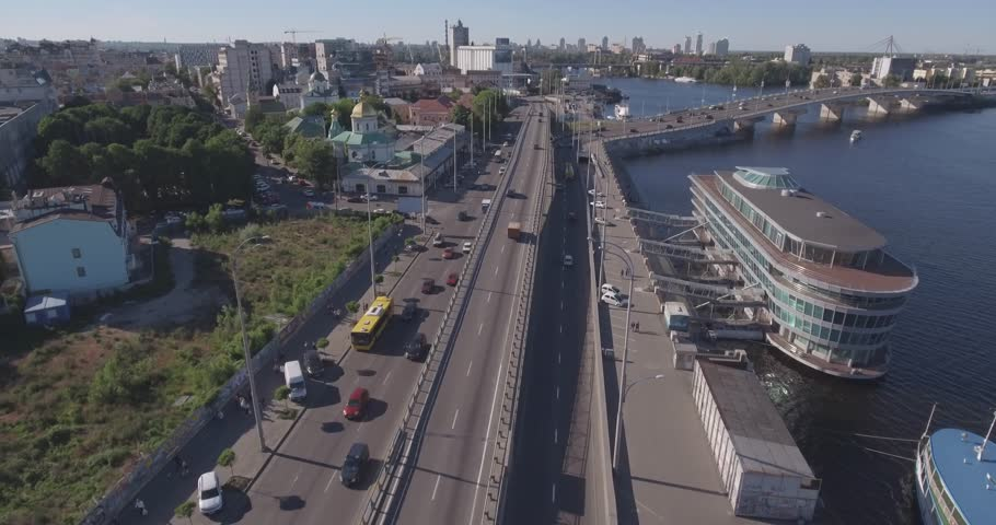 The Dnieper river in the city of Kiev, aerial. Pleasure boats on the Dnieper River. Panorama of kiev from the air. Cars are driving along the highway near the pond. Old quarter on the shore.   | Shutterstock HD Video #28147465