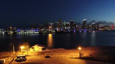 MIAMI, FL, USA - JUNE 24, 2017: Aerial drone video Downtown Miami twilight at night 4k port biscayne bay