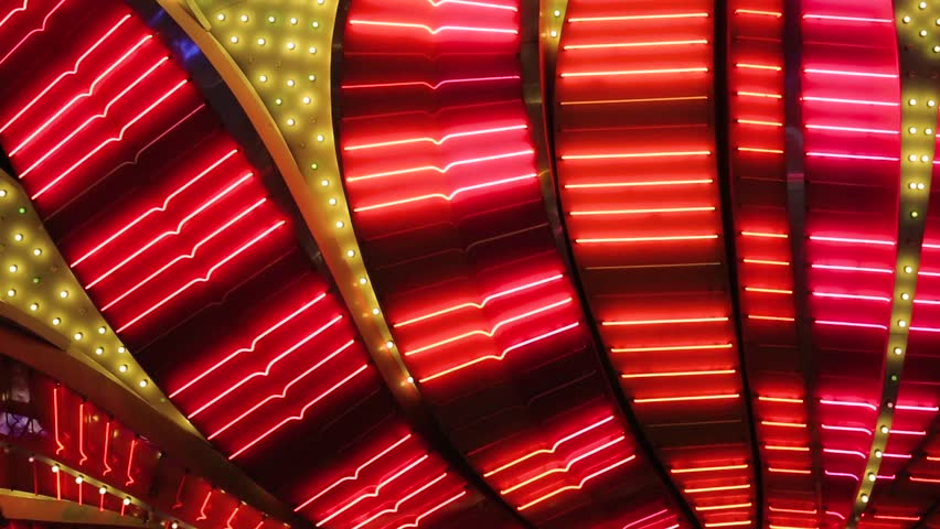 Las Vegas Neon Lights close-up. Neon flashing lights of Las Vegas Casino. Flashing neon light on the famous Las Vegas Strip. Bright night entertainment and advertisement at resort hotel and casino. | Shutterstock HD Video #28159225