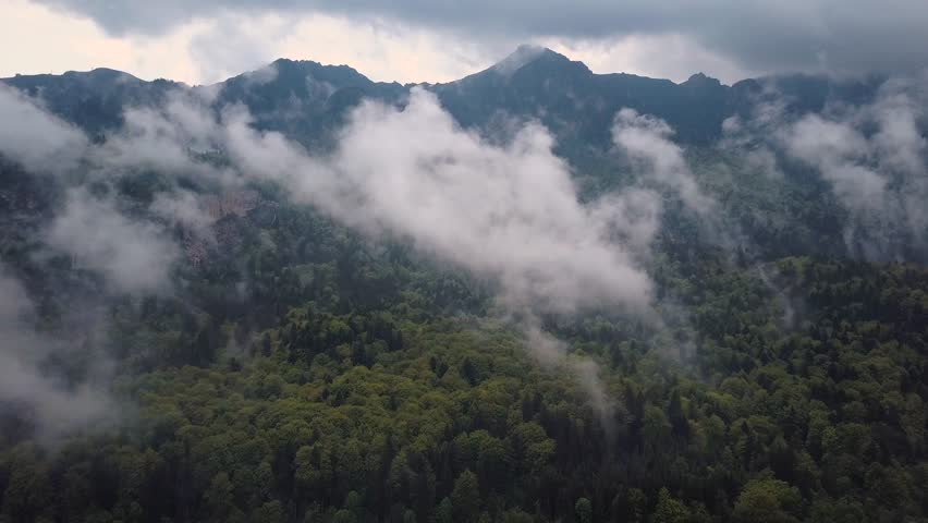 Aerial View. Flying over the high mountains in beautiful misty clouds . Aerial camera shot. Air clouds. | Shutterstock HD Video #28192855