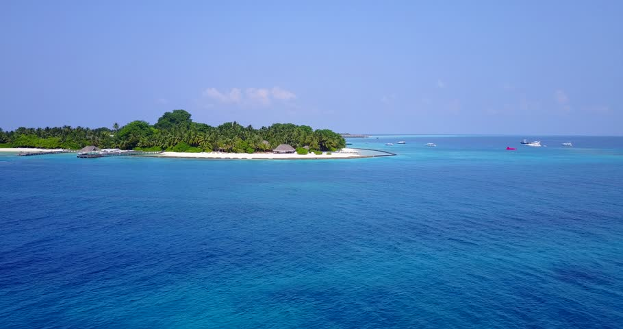 Aerial flying drone view of Maldives white sandy beach on sunny tropical paradise island with aqua blue sky sea water ocean 4k | Shutterstock HD Video #28216255