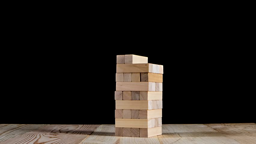 Simple Dark Basement Stairs Puzzles Jenga Gather In Tall Tower Stop Motion  Black Background Stock Dark