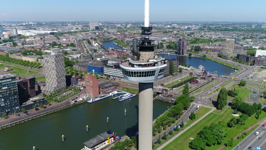 Aerial footage circling around Euromast an observation tower in Rotterdam Netherlands it was specially built for the 1960 Floriade and is a listed monument since 2010 very tall structure 4k quality