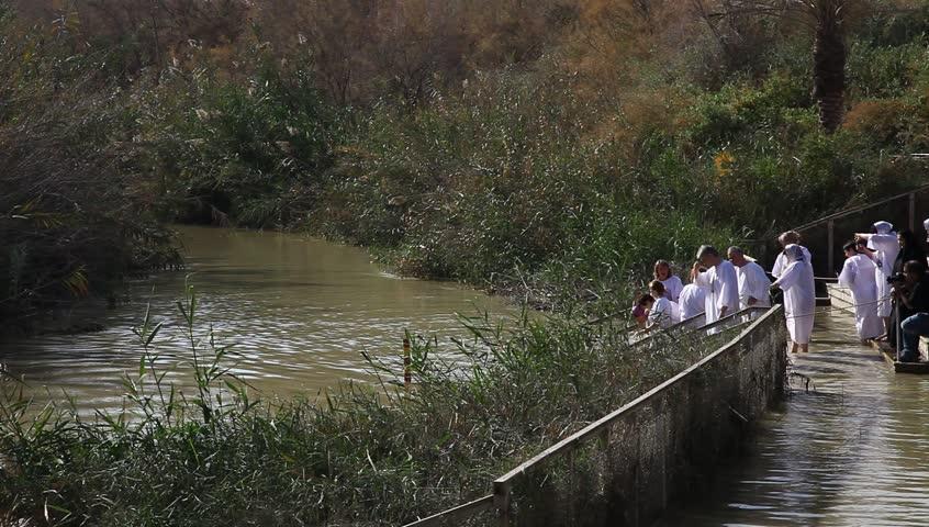 QASR AL YAHUD, ISRAEL JANUARY 18: Greek Orthodox pilgrims baptize during the Epiphany at