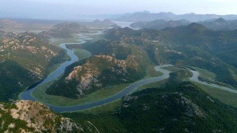 Flying over Rijeka Crnojevica River. Northern area of Skadar Lake National Park in Montenegro