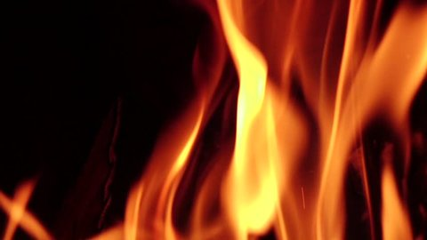 Fireplace burning. Warm cozy fire in fireplace, closeup. Slow motion