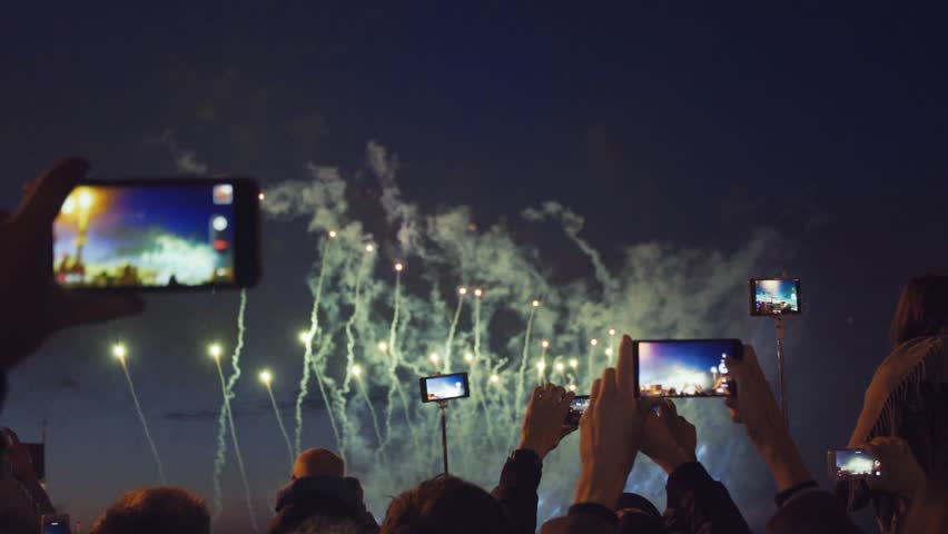 Peoples filming fireworks on a mobile phone. Slow motion