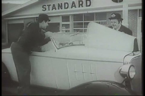 1920s: Laurel and Hardy impersonators work as Standard Oil service station attendants, in a television commercial, in the 1960s.
