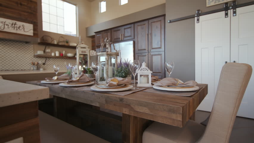 Rising Rack Focus From Dining Table To Corner Kitchen. Shot Racks Focus  From Close Up