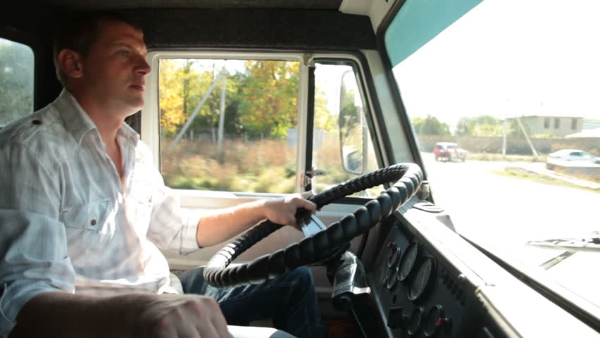 Truck Driver Using Mobile Phone In Cab Of Delivery Truck Stock ...