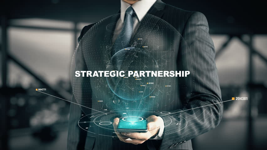 Businessman with Strategic Partnership hologram concept