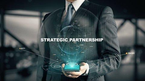 Businessman with Strategic Partnership hologram concept