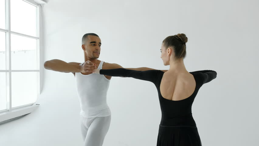 A pair of ballet dancers sensually dance in the white room of the ballet school 20s 4k.