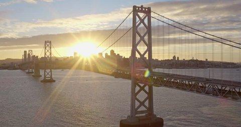 Aerial of Sun Shining through San Francisco Bay Bridge, Golden Hour