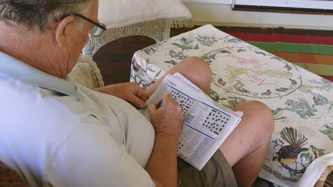 BRISBANE, AUSTRALIA - June 5 2017: A crossword is a word puzzle where you fill the white squares with letters, forming words. Doing crosswords may be linked to a lower risk of Alzheimer's disease.