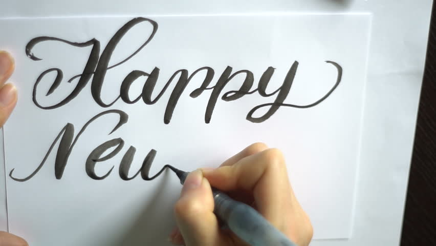 Text of a happy new year brush on paper   Shutterstock HD Video #28416625