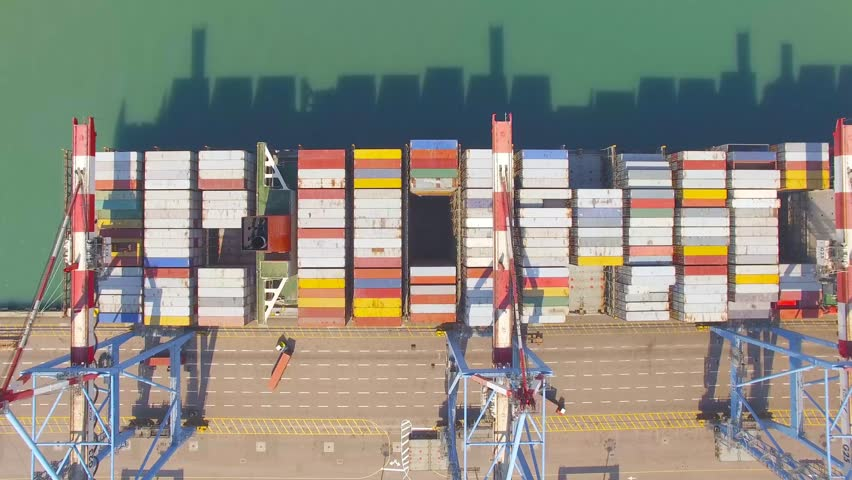 Commercial port with container ships - Top down aerial view. | Shutterstock HD Video #28469155