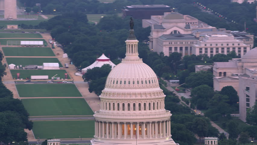 Washington, D.C. circa-2017, Close-up aerial view of the Capital Dome and Washington D.C. Shot with Cineflex and RED Epic-W Helium. | Shutterstock HD Video #28499155
