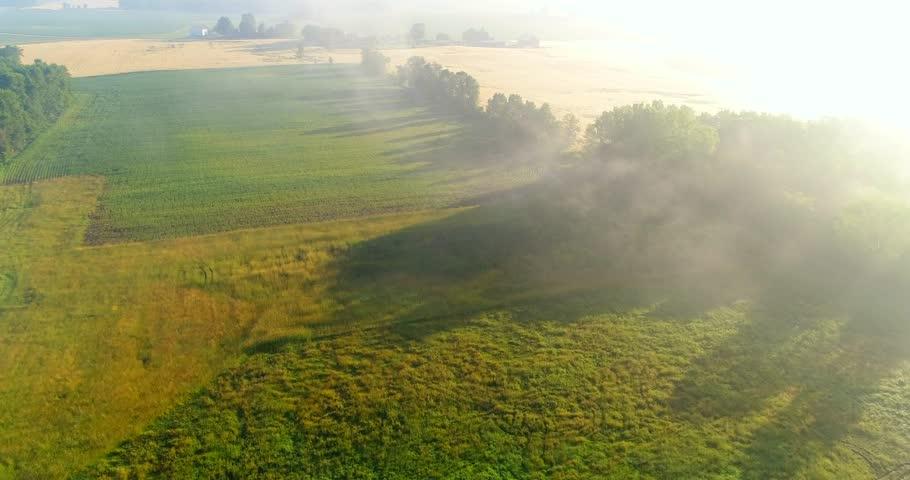 Breathtaking aerial view of farm fields through foggy sunrise.    Shutterstock HD Video #28516825