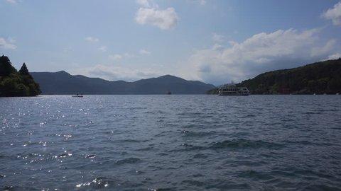 Tourist boats and Hakone shrine red gate at lake Ashi in Hakone, Kanagawa Prefecture, Japan