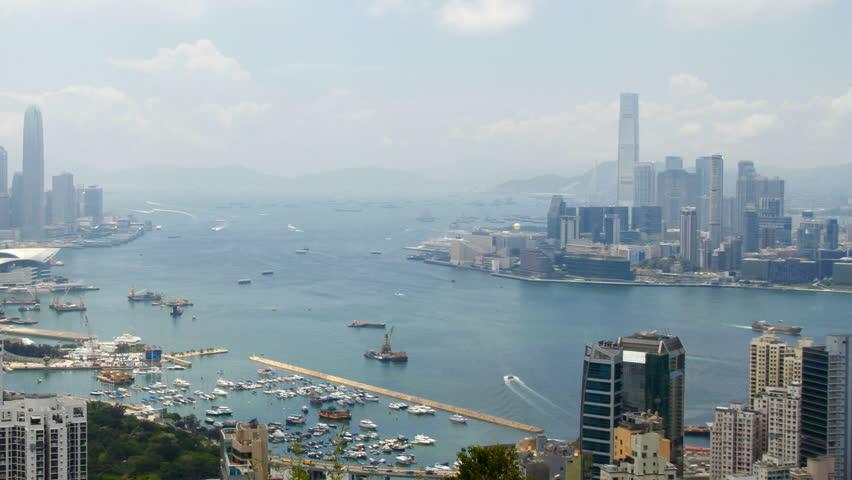 Hong Kong Harbor panorama cityscape - Central District, Victoria Harbor, Victoria Peak, Hong Kong Island and Kowloon, Hong Kong.   Shutterstock HD Video #2853625