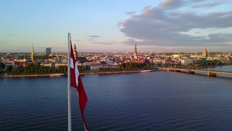 Beautiful huge flag of Latvia in the center of Riga. Quick rotation around the flag